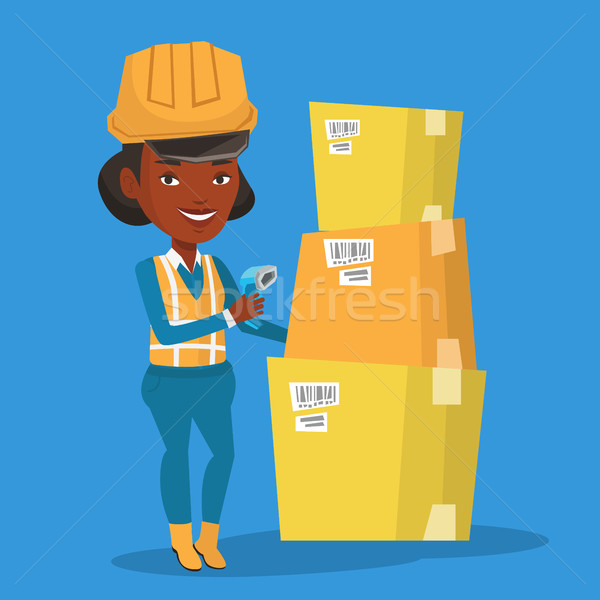 Warehouse worker scanning barcode on box. Stock photo © RAStudio
