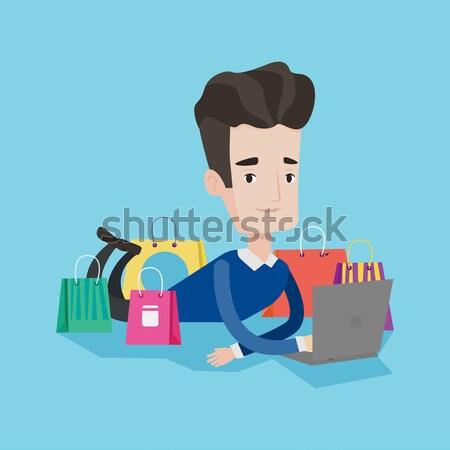 ストックフォト: 男 · ショッピング · を · 小さな · アジア · ラップトップを使用して