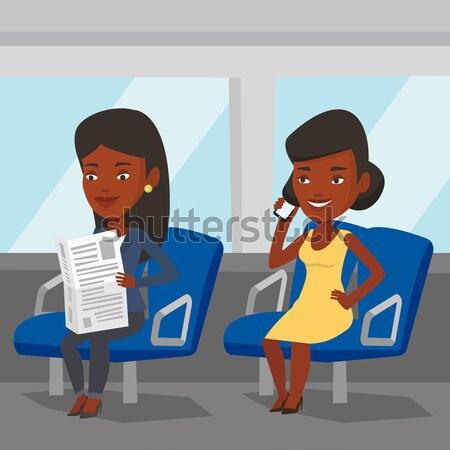 Pessoas transporte público mulher telefone leitura Foto stock © RAStudio