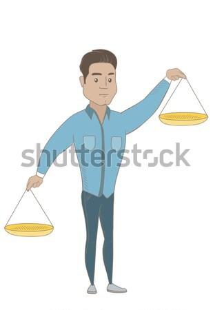 Caucasian business woman holding balance scale. Stock photo © RAStudio