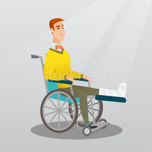 Man with broken leg sitting in a wheelchair. Stock photo © RAStudio