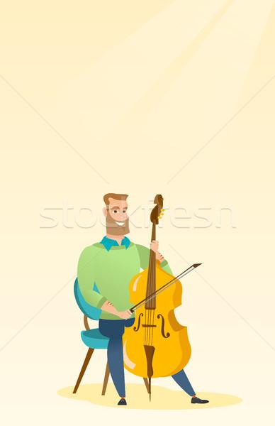 Homem jogar violoncelo jovem caucasiano sessão Foto stock © RAStudio