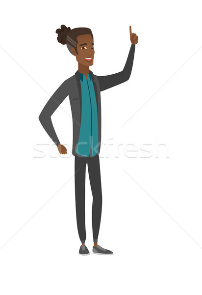 Afrika işadamı işaret işaret parmağı yukarı Stok fotoğraf © RAStudio