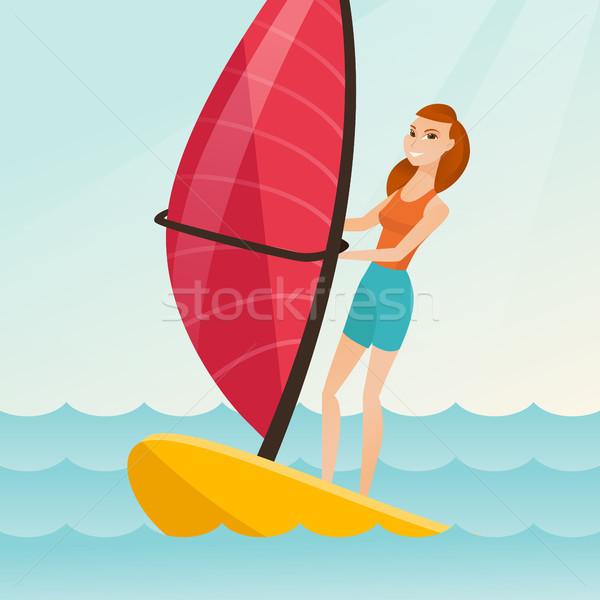Young caucasian woman windsurfing in the sea. Stock photo © RAStudio
