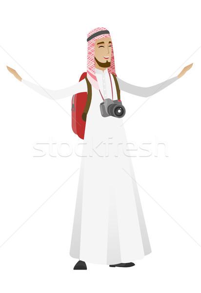 Traveler man jumping through a big map pointer. Stock photo © RAStudio