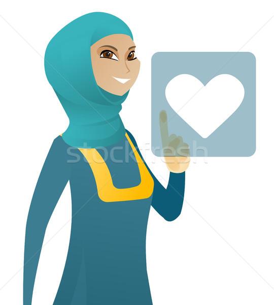 Business woman pressing web button with heart. Stock photo © RAStudio