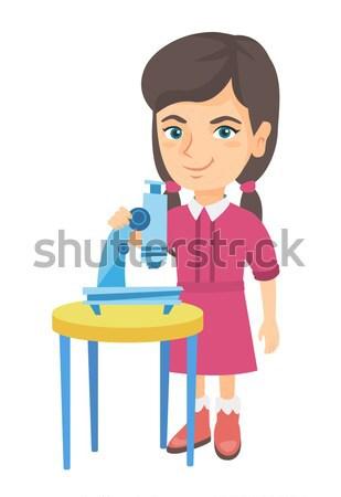Pequeno asiático aluna microscópio feliz experiência Foto stock © RAStudio