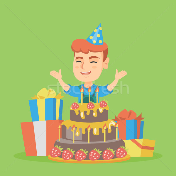 Little caucasian boy jumping out of a large cake. Stock photo © RAStudio