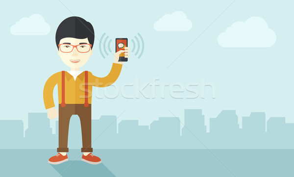 Japanese Office worker and his smartphone. Stock photo © RAStudio