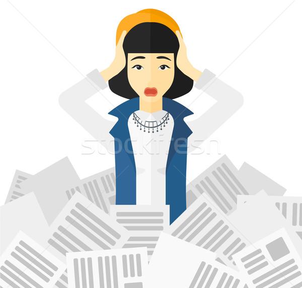 Woman in stack of newspapers. Stock photo © RAStudio