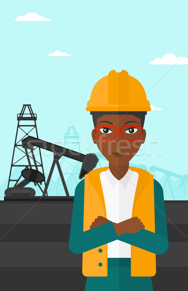 Oliearbeider vrouw helm permanente armen olie Stockfoto © RAStudio