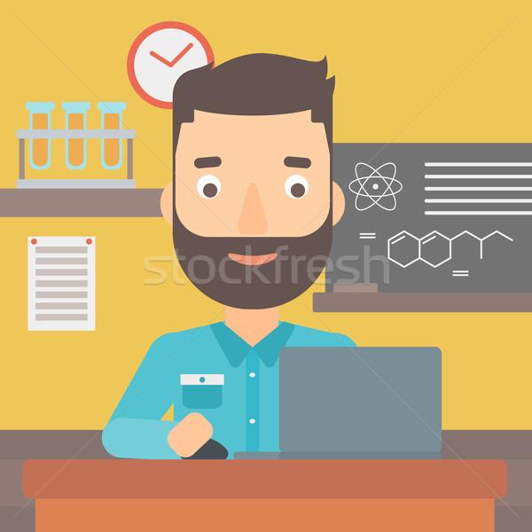 Férfi tanul laptop hipszter szakáll ül Stock fotó © RAStudio