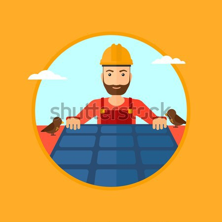 Constructor installing solar panels. Stock photo © RAStudio