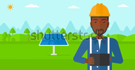 Female worker of solar power plant and wind farm. Stock photo © RAStudio