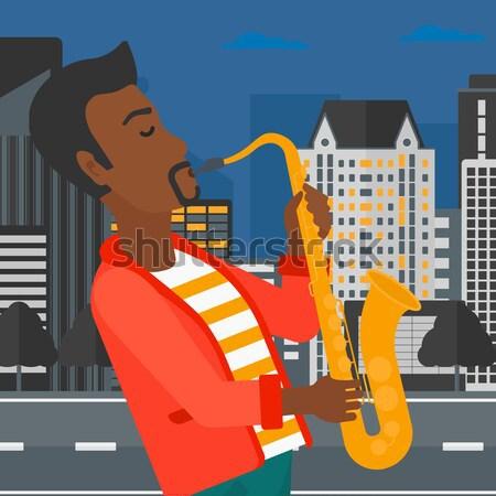 Músico jogar saxofone homem noite cidade Foto stock © RAStudio