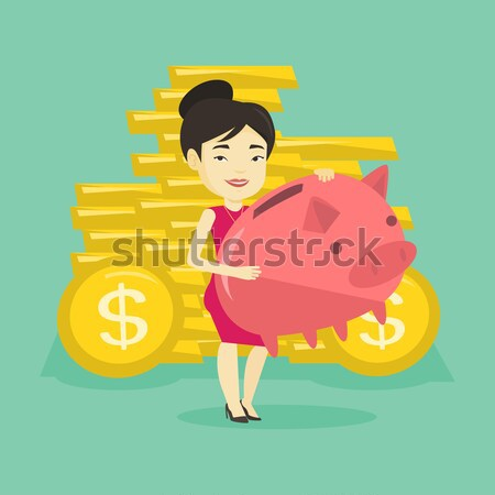 Femme d'affaires grand tirelire africaine pièces d'or Photo stock © RAStudio