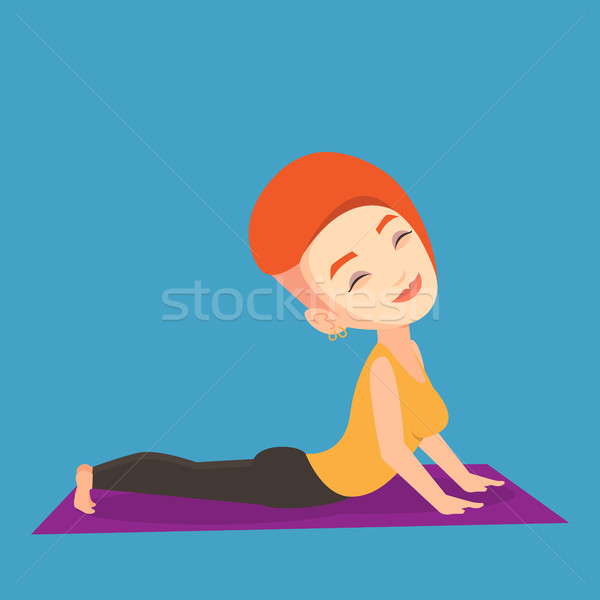 Woman practicing yoga upward dog pose. Stock photo © RAStudio