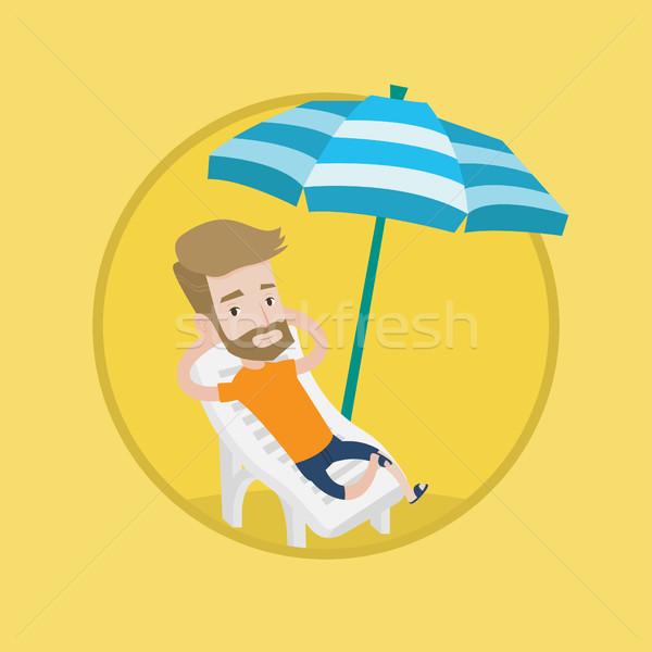 Adam rahatlatıcı şezlong oturma plaj Stok fotoğraf © RAStudio