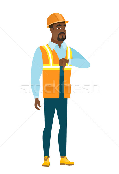 Disappointed african builder with thumb down. Stock photo © RAStudio