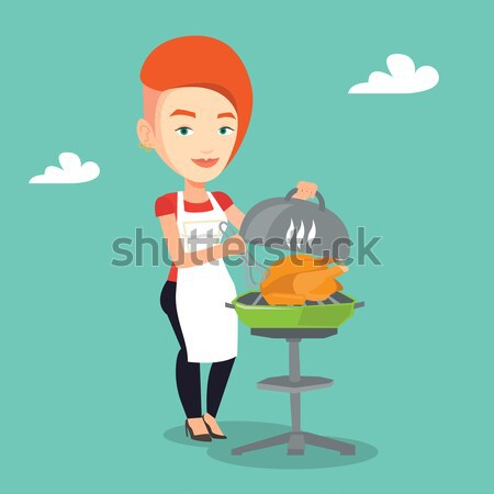 Woman cooking chicken on barbecue grill. Stock photo © RAStudio