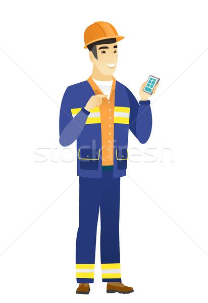 ázsiai építész tart mobiltelefon fiatal mutat Stock fotó © RAStudio