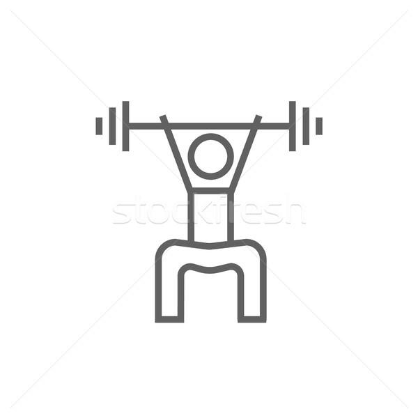 Man exercising with barbell line icon. Stock photo © RAStudio