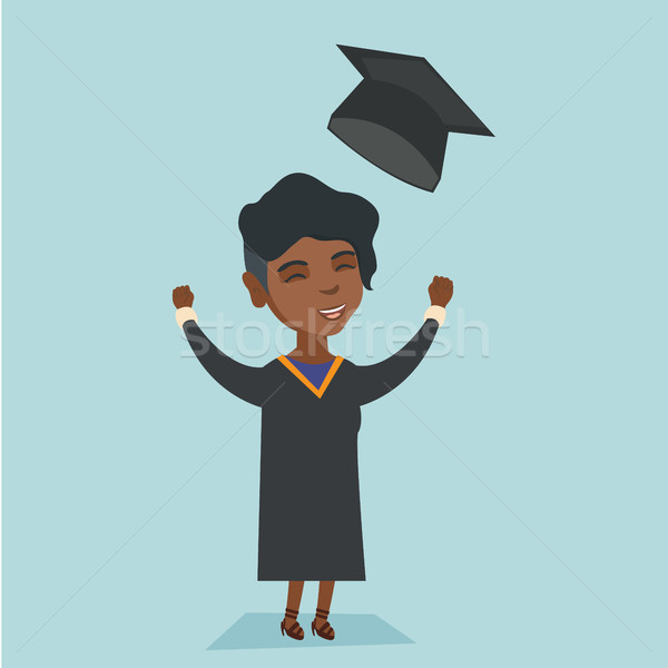 African graduate throwing up graduation hat. Stock photo © RAStudio