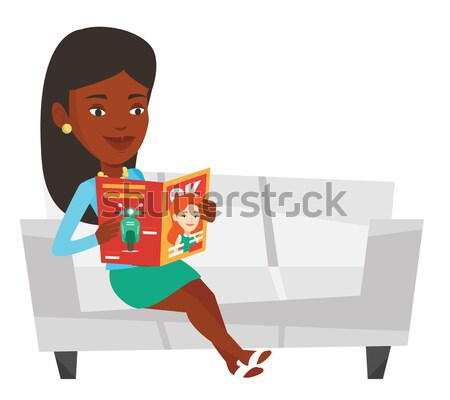 Woman sitting on the couch and reading a magazine. Stock photo © RAStudio