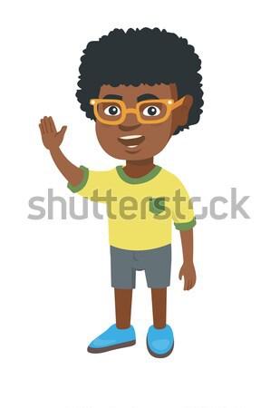 African-american little boy waving hand. Stock photo © RAStudio