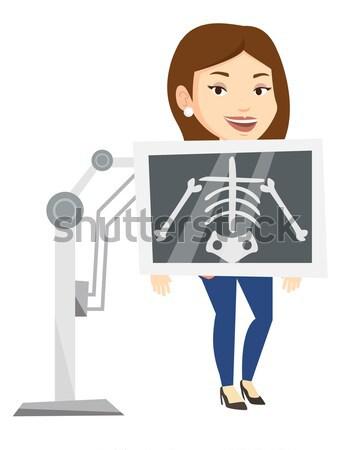Paciente raio x jovem asiático mulher Foto stock © RAStudio