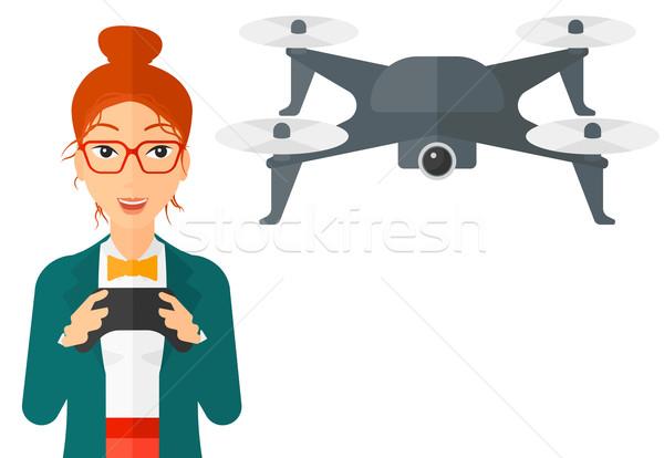 Woman flying drone. Stock photo © RAStudio
