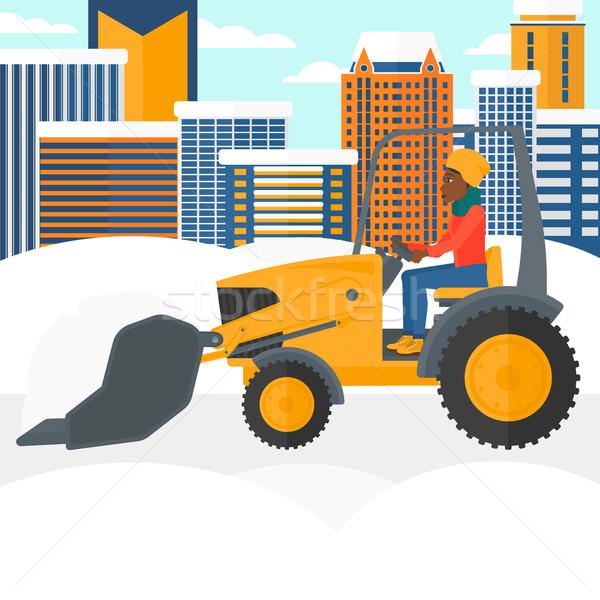 Woman plowing snow. Stock photo © RAStudio