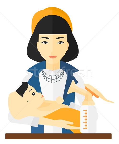 Woman with breast pump. Stock photo © RAStudio