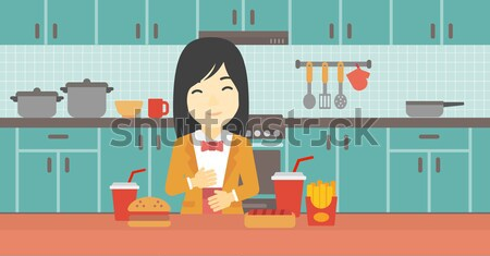 Vrouw lijden maagzuur permanente keukentafel vol Stockfoto © RAStudio