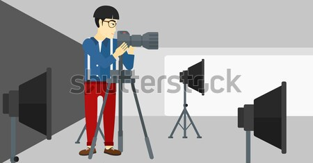 Photographer working with camera on tripod. Stock photo © RAStudio