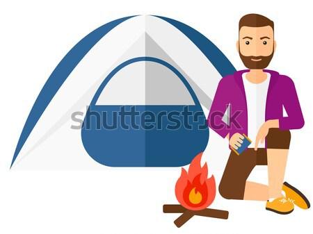 Hombre hoguera camping tienda turísticos Foto stock © RAStudio