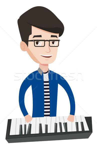 Férfi játszik zongora fiatal mosolyog zenész Stock fotó © RAStudio