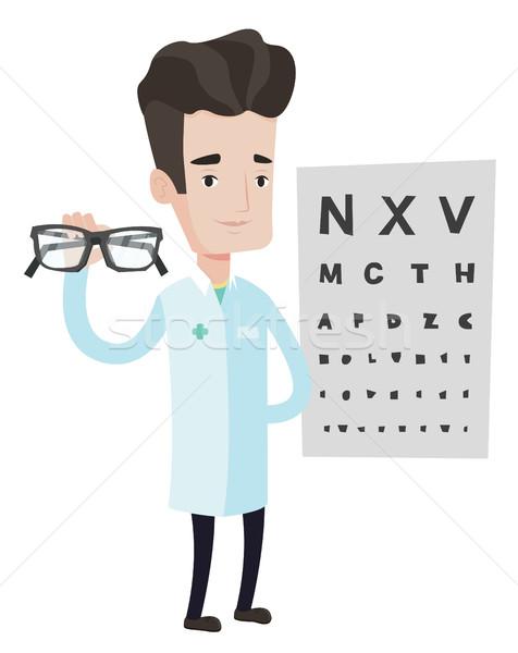Szemorvos tart szemüveg kaukázusi férfi szemorvos Stock fotó © RAStudio