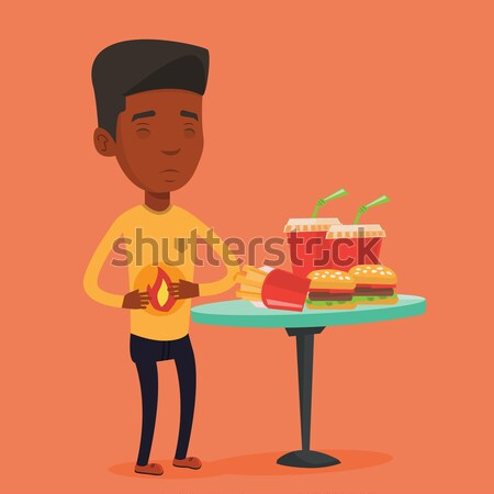 Uomo sofferenza bruciore di stomaco triste mal di stomaco fast food Foto d'archivio © RAStudio