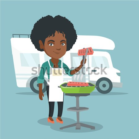Woman having barbecue in front of camper van. Stock photo © RAStudio