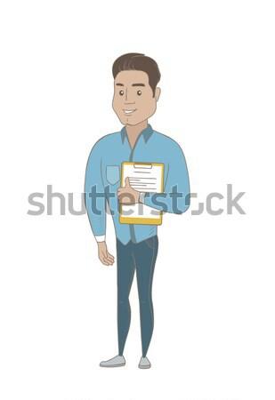 Businessman holding clipboard with documents. Stock photo © RAStudio