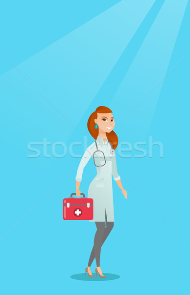 Doctor holding first aid box vector illustration  vector