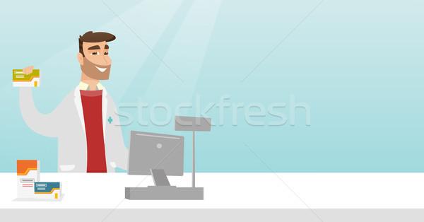 Apotheker tonen geneeskunde jonge medische toga Stockfoto © RAStudio