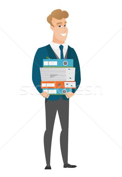 Groom holding pile of folders. Stock photo © RAStudio