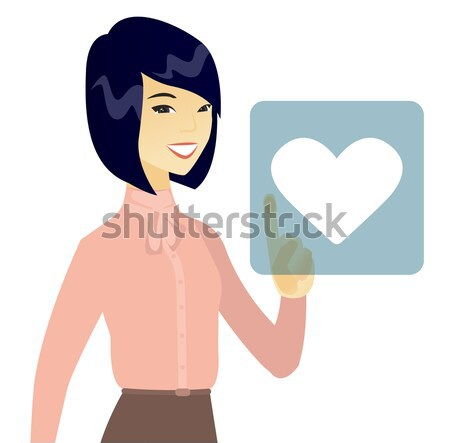 Young asian fiancee holding tablet computer. Stock photo © RAStudio