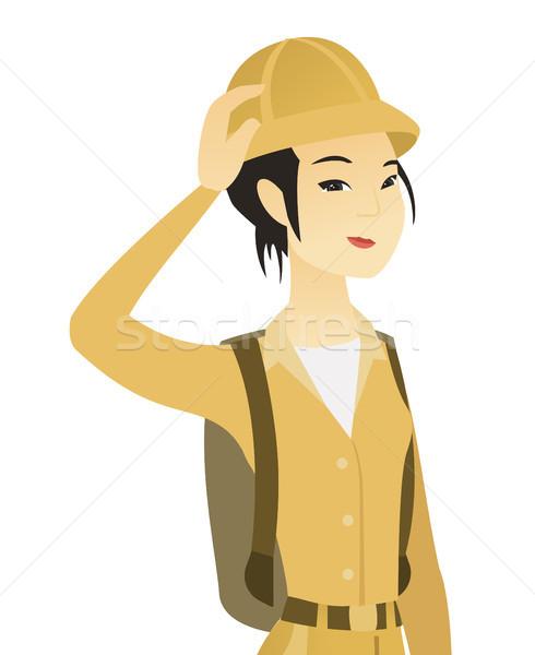 Stock photo: Young asian traveler scratching head.