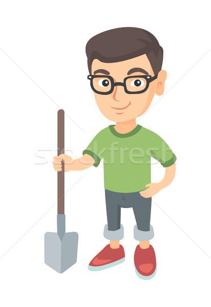 Caucasian smiling boy in glasses holding a shovel. Stock photo © RAStudio