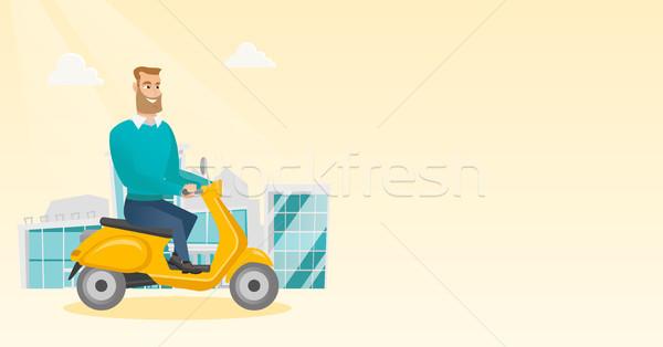 Young caucasian man riding a scooter. Stock photo © RAStudio