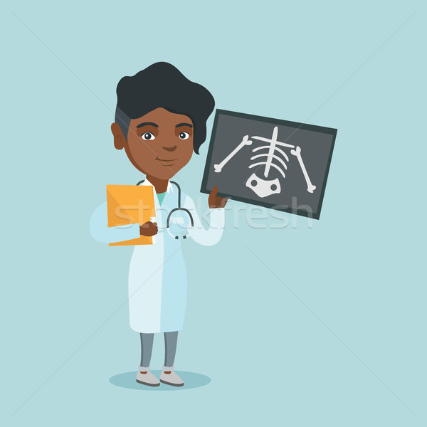 African roentgenologist examining a radiograph. Stock photo © RAStudio