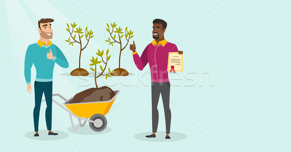 Two young multicultural men plant trees. Stock photo © RAStudio